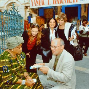 Guiding President Ellen Johnson of Liberia at the Muristan market, Jerusalem